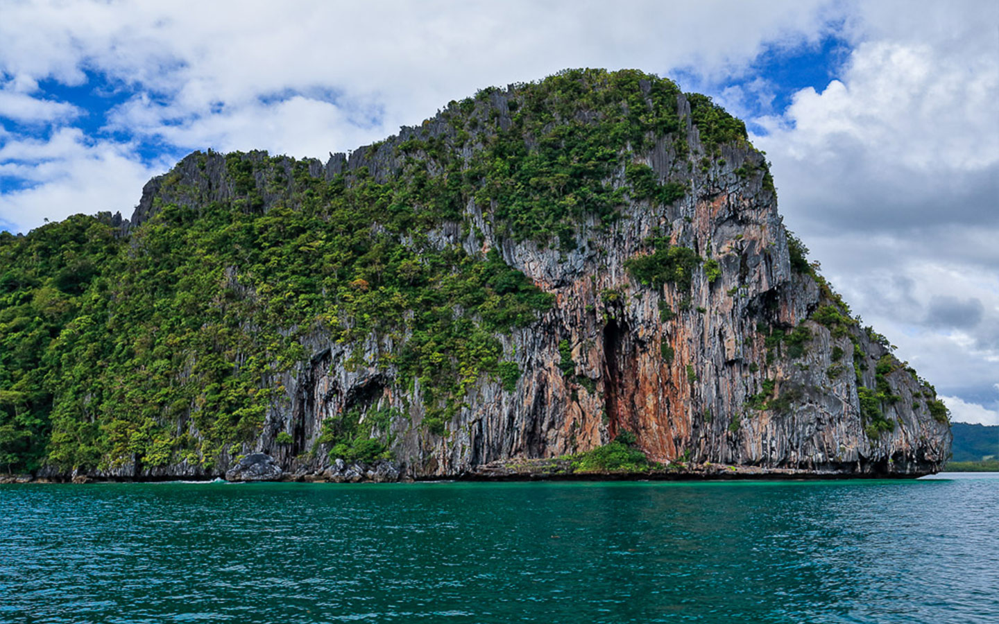 eroded limestone cliffs in a small Palawan lagoon